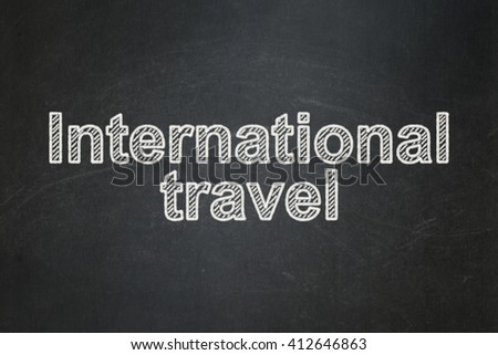 Tourism concept: text International Travel on Black chalkboard background