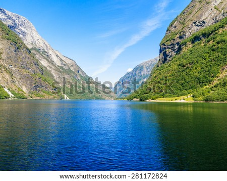 Tourism vacation and travel. Mountains and fjord Sognefjord in Norway, Scandinavia. - stock photo