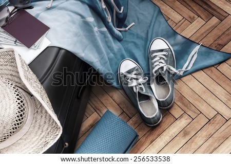 tourism vintage background. Suitcase with things for the trip - stock photo