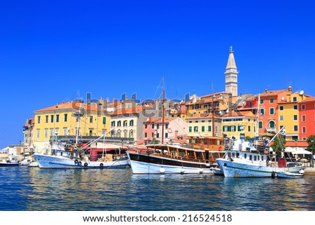 Tourist and fishing vessels in the harbor of Venetian town near the Adriatic sea, Rovinj, Croatia - stock photo