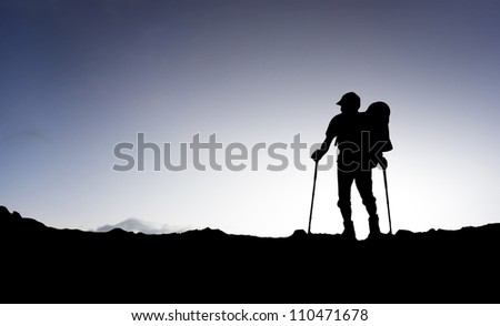 Tourist and on sky background. Sport and active life - stock photo