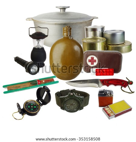 Tourist and survival equipment. Isolated on white - stock photo
