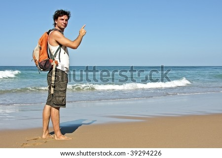 Tourist asking the road at the beach - stock photo