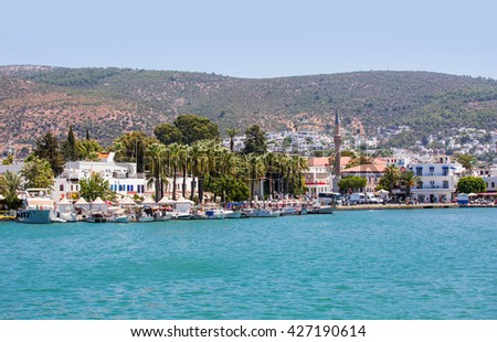 Tourist attractions in Bodrum during summer, people walking and shopping. - stock photo