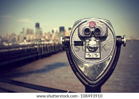 tourist binoculars at Liberty Island in front of Manhattan Skyline, vintage style, New York City, USA
