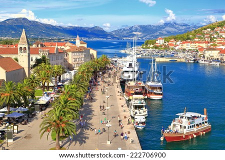 Tourist boat approaching the pier of Venetian old town near the Adriatic sea, Trogir, Croatia - stock photo