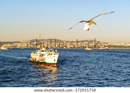Tourist boat floats along the Bosphorus on the background of the Asian part of Istanbul, Turkey - stock photo