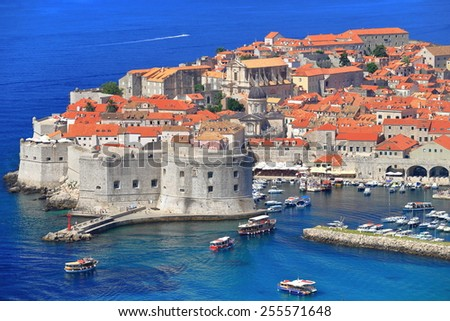Tourist boats enter fortified harbor of Dubrovnik, Croatia