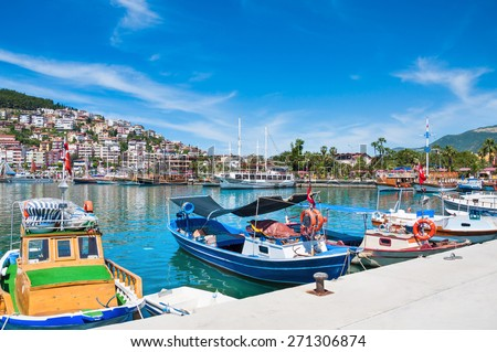 Tourist boats in the port of Alanya, Turkey. Beautiful view of the beach - stock photo