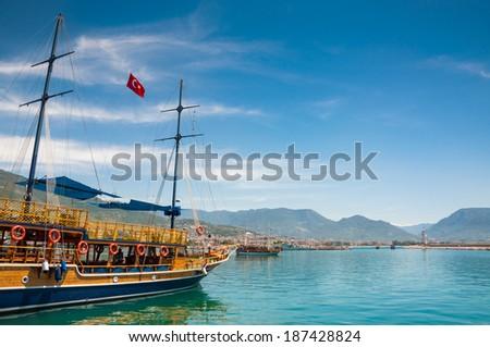 Tourist boats on the sea coast. Port in Alanya, Turkey - stock photo