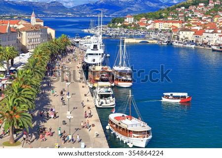 Tourist boats populating the harbor of Trogir, Croatia - stock photo