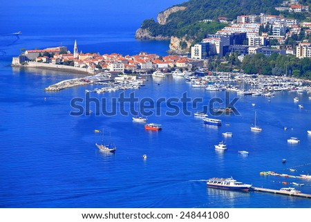 Tourist boats spread in the marina of an old Venetian town by the Adriatic sea, Budva, Montenegro