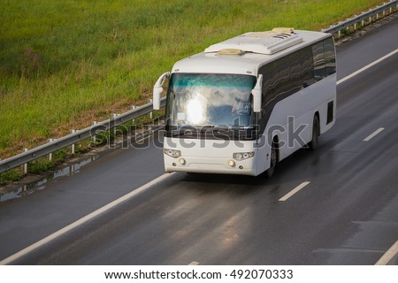 tourist bus goes on asphalted country  highway