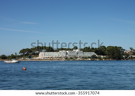 Tourist center on Saint Nicholas island, near of city Porec in Croatia - stock photo