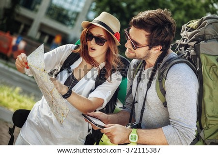 Tourist Couple In The City Browsing Map Using Digital Tablet