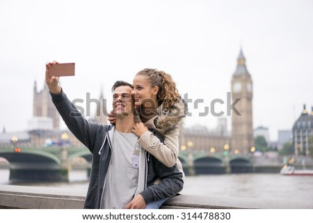Tourist Couple taking selfie at Big Ben, London - stock photo