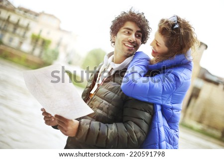 tourist couple view map the city of Verona