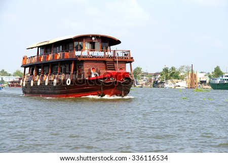Tourist cruise ship on the Mekong River,  Vietnam - stock photo