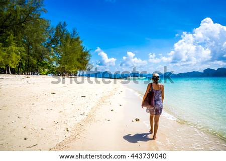 Tourist enjoying a tropical beach in Thailand