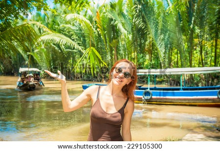 Tourist enjoying Mekong delta cruise with daily trips to local sights