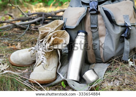 Tourist equipment in the forest - stock photo