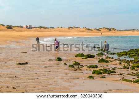 Tourist family visiting beach in Oualidia, Atlantic coast of Morocco