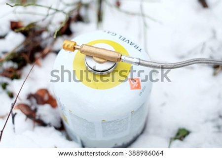 Tourist gas cylinder - stock photo
