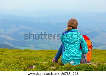 tourist girl and mountain views, norway - stock photo