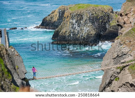 Tourist girl in the bridge in beautiful ocean landscape - stock photo