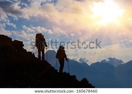 tourist group on a mount slope - stock photo