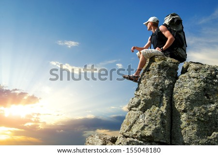 Tourist in mountain.  - stock photo