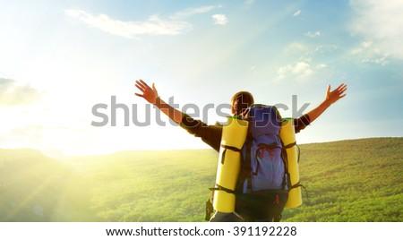 Tourist in mountain. Conceptual scene. - stock photo