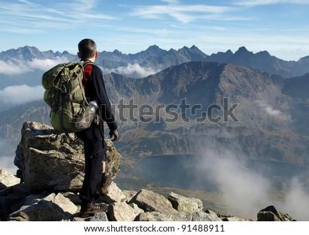 Tourist in the mountains - stock photo