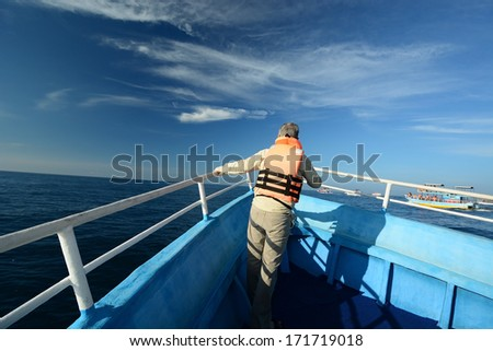 Tourist in the whale and dolphin watching boat  - stock photo