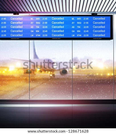 Tourist info signage informing on cancellation of planes flights in airport - stock photo