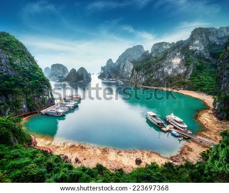 Tourist junks floating among limestone rocks at Ha Long Bay, South China Sea, Vietnam, Southeast Asia - stock photo