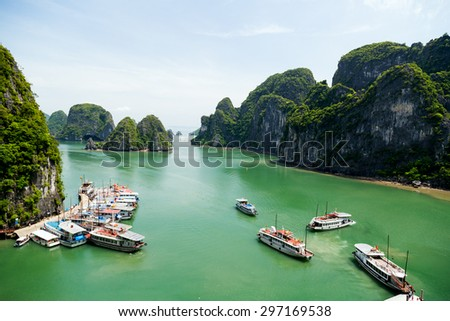 Tourist junks floating among limestone rocks at Halong Bay. Halong Bay is the World's Natural heritage.