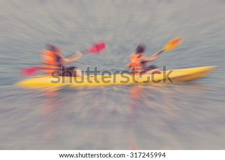 Tourist kayaking in the Thai ocean with radial blur,retro effect - stock photo