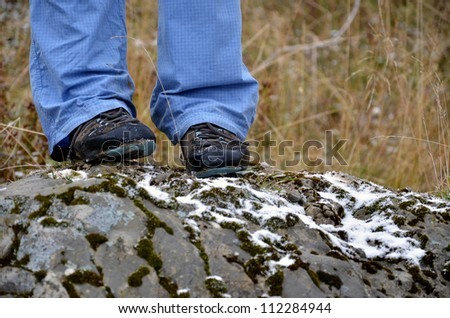 Tourist legs in the nature in close view - stock photo