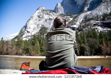 Tourist looking at a spectacular mountain view - stock photo