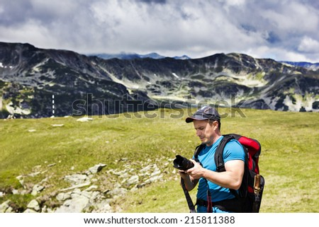Tourist looking taking photos during a hiking trip