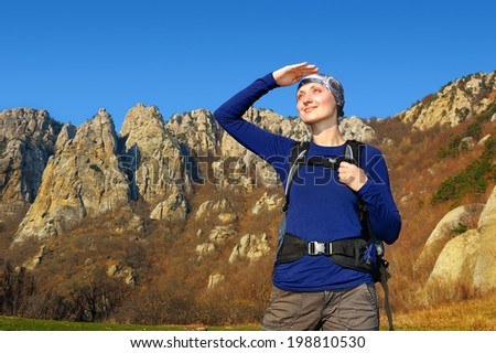 tourist looking to the mountains - stock photo