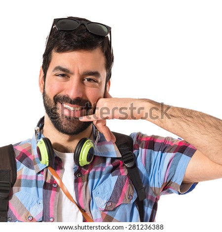 Tourist making phone gesture - stock photo