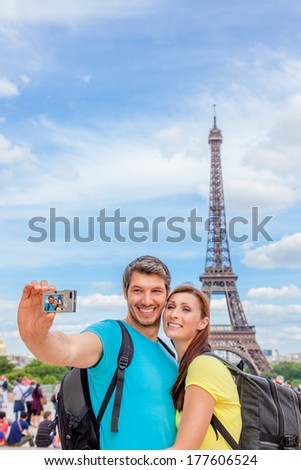 tourist making picture visiting city of love - stock photo