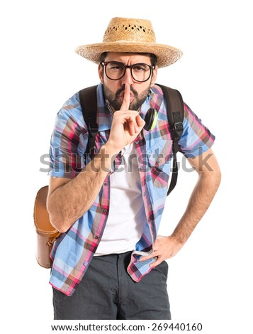 Tourist making silence gesture  - stock photo