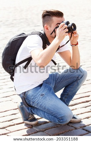 Tourist. Man during vacation trip - stock photo