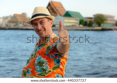 Tourist man giving thumb up