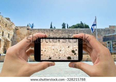 tourist man taking photo with the smartphone at western wall of jerusalem israel - stock photo