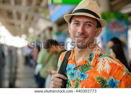 Tourist man waiting for train