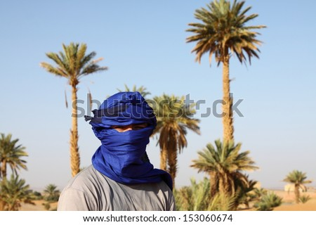 Tourist men with typical nomad head cover - blue turban morocco sahara - stock photo